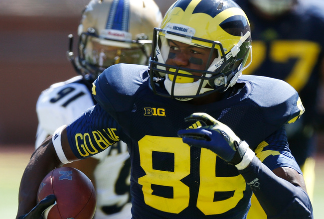Hi-res-180548935-jehu-chesson-of-the-michigan-wolverines-runs-for-a_crop_650x440