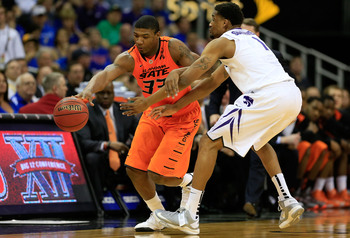Hi-res-163781092-marcus-smart-of-the-oklahoma-state-cowboys-controls-the_display_image