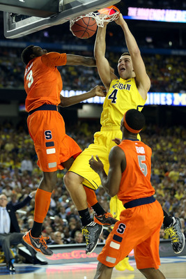 Hi-res-165881222-mitch-mcgary-of-the-michigan-wolverines-dunks-in-the_display_image
