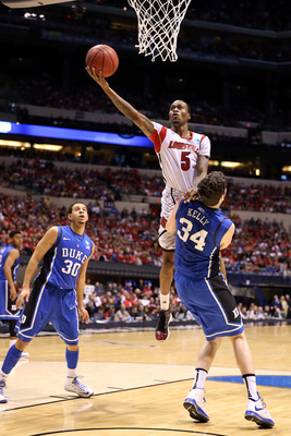 Hi-res-165851128-kevin-ware-of-the-louisville-cardinals-drives-for-a_display_image