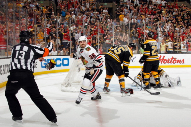 171865898-dave-bolland-of-the-chicago-blackhawks-celebrates-after_crop_650