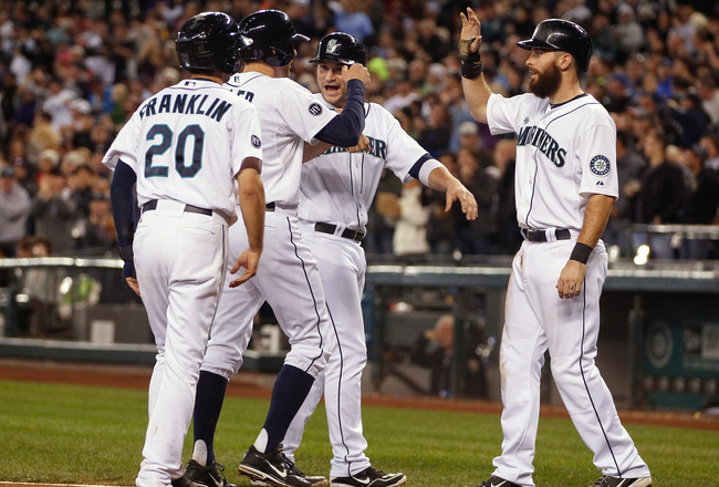 Hi-res-182189666-brad-miller-of-the-seattle-mariners-is-congratulated-by_crop_650x440