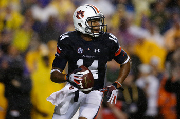 Hi-res-181493331-nick-marshall-of-the-auburn-tigers-looks-to-throw-a_display_image