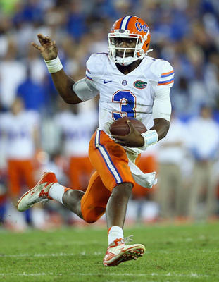 Hi-res-182263403-tyler-murphy-of-the-florida-gators-runs-with-the-ball_display_image