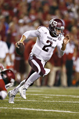 Hi-res-182258160-johnny-manziel-of-the-texas-a-m-aggies-rolls-out-of-the_display_image