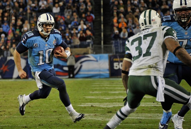 Hi-res-158527006-quarterback-jake-locker-carries-the-ball-for-a-thirteen_crop_650x440