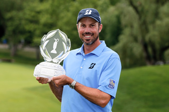 Hi-res-169825267-matt-kuchar-poses-with-the-trophy-after-his-two-stroke_display_image
