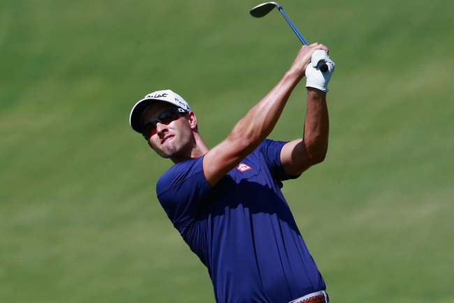 Hi-res-181325642-adam-scott-of-australia-hits-his-approach-shot-on-the_crop_650