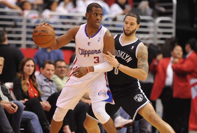 Hi-res-164495621-chris-paul-of-the-los-angeles-clippers-protects-the_crop_650x440