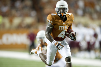 Hi-res-179158186-daje-johnson-of-the-texas-longhorns-breaks-free-for-a_display_image
