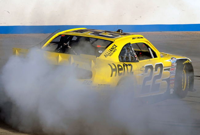 Hi-res-182189601-joey-logano-driver-of-the-hertz-ford-celebrates-with-a_crop_650x440