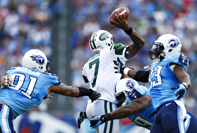 Hi-res-182388189-geno-smith-of-the-new-york-jets-is-hit-while-throwing-a_crop_650x440