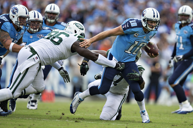 Hi-res-182444786-jake-locker-of-the-tennessee-titans-runs-the-ball-and_crop_650