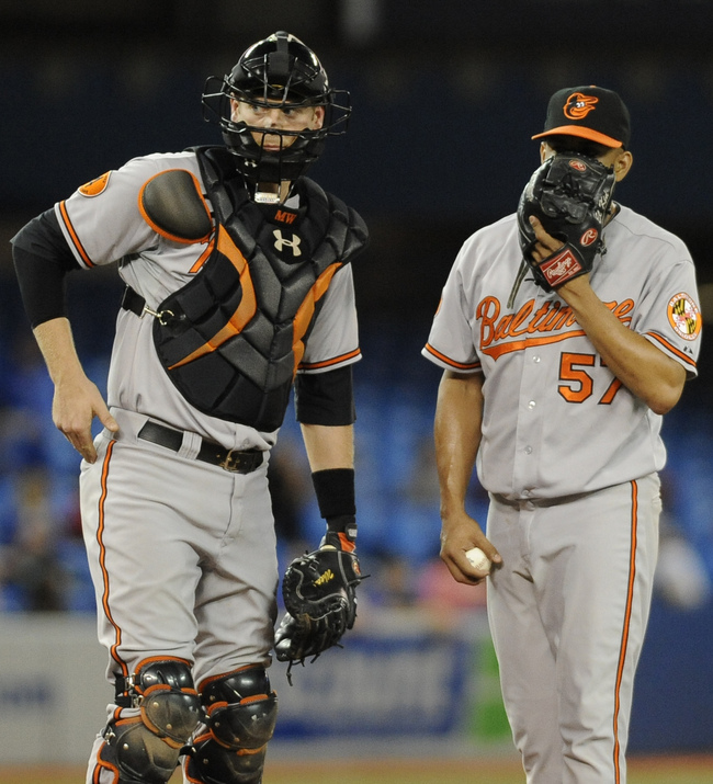 Hi-res-180645677-catcher-matt-wieters-and-pticher-francisco-rodriguez-of_crop_650