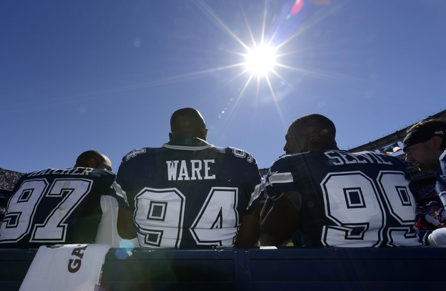 Hi-res-182388871-demarcus-ware-talks-with-teammates-jason-hatcher-and_crop_650