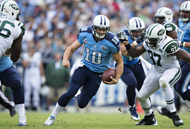 Hi-res-182444789-jake-locker-of-the-tennessee-titans-runs-the-ball_crop_650x440