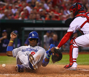Hi-res-175753648-yasiel-puig-of-the-los-angeles-dodgers-scores-a-run_display_image