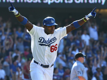 Hi-res-174741840-yasiel-puig-of-the-los-angeles-dodgers-celebrates-as-he_display_image