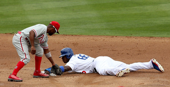 Hi-res-172011754-yasiel-puig-of-the-los-angeles-dodgers-holds-on-to_display_image