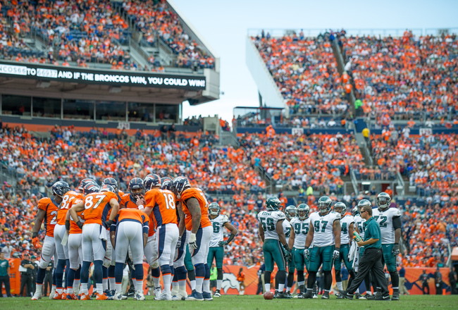 Hi-res-182449681-the-denver-broncos-huddle-around-peyton-manning-as-the_crop_650x440