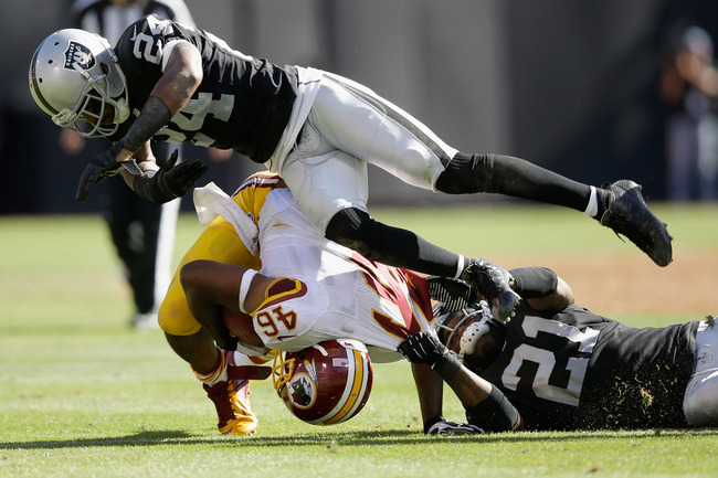 Hi-res-182407197-charles-woodson-of-the-oakland-raiders-and-mike-jenkins_crop_650