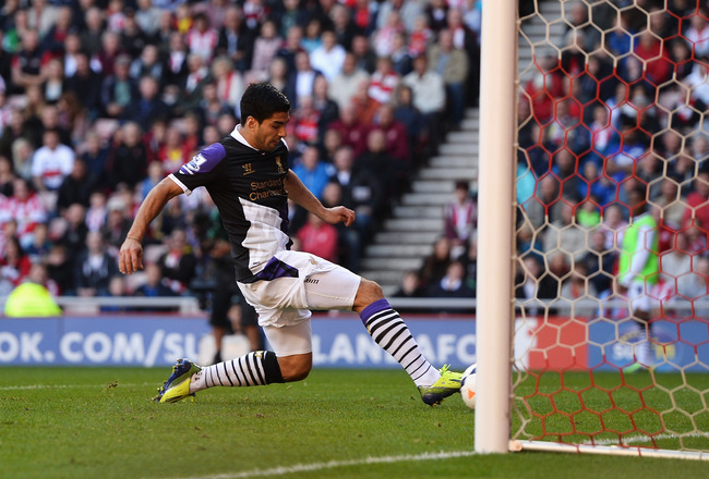 Hi-res-182287332-luis-suarez-of-liverpool-scores-his-teams-second-goal_crop_650x440