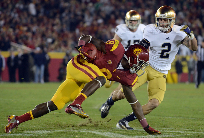 Hi-res-157044807-marqise-lee-of-the-usc-trojans-keeps-his-balance-after_crop_650x440