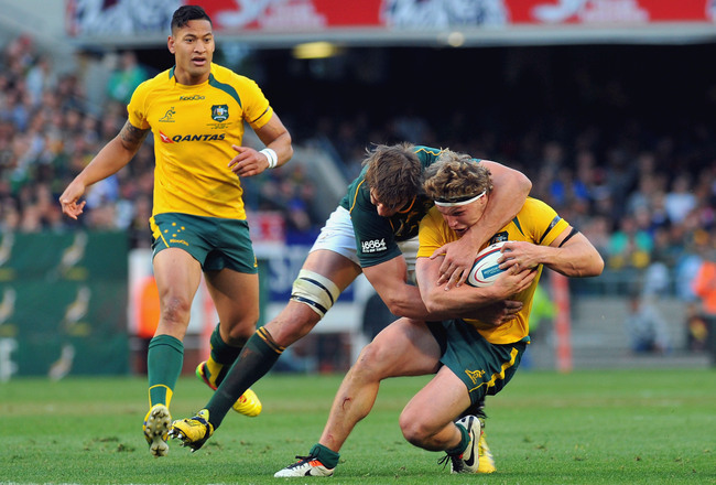 Hi-res-182139223-michael-hooper-of-the-wallabies-is-tackled-by-eben_crop_650x440