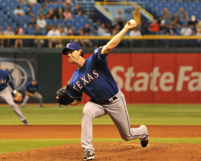 Hi-res-180917368-pitcher-neal-cotts-of-the-texas-rangers-throws-in_crop_650