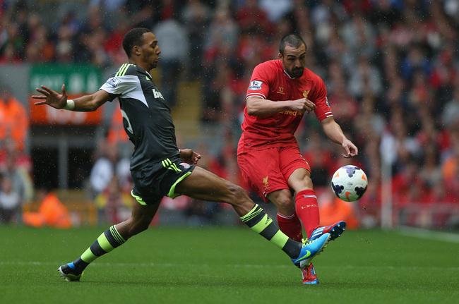 Hi-res-176694738-jose-enrique-of-liverpool-passes-the-ball-past-steven_crop_650