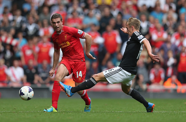 Hi-res-181443028-jordan-henderson-of-liverpool-passes-the-ball-past_crop_650