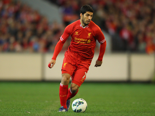 Hi-res-174334438-luis-suarez-of-liverpool-runs-with-the-ball-during-the_crop_650