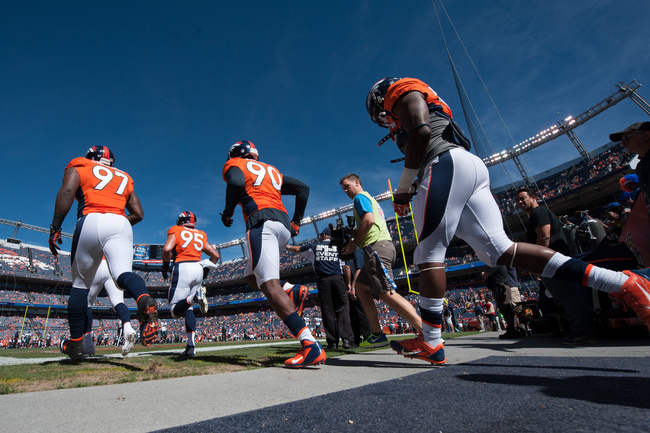 Hi-res-182449651-denver-broncos-players-including-malik-jackson-derek_crop_650