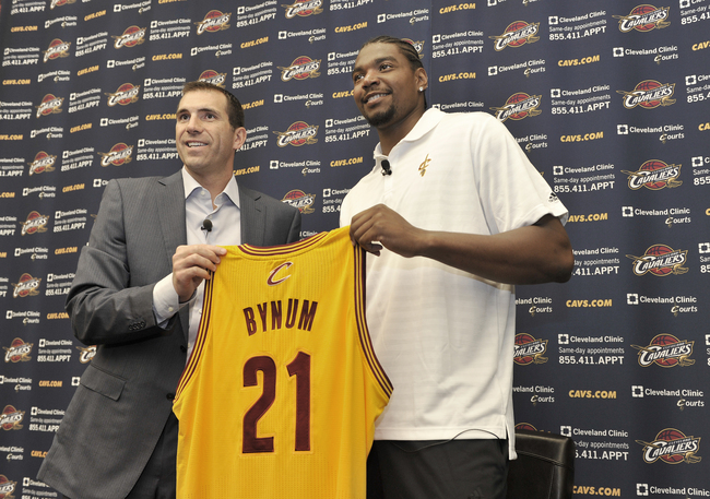 Hi-res-174244631-andrew-bynum-holds-up-his-new-jersey-as-he-is_crop_650