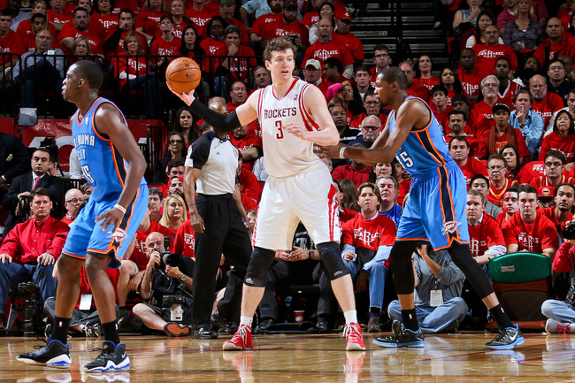 Hi-res-168005749-omer-asik-of-the-houston-rockets-looks-to-pass-the-ball_crop_650