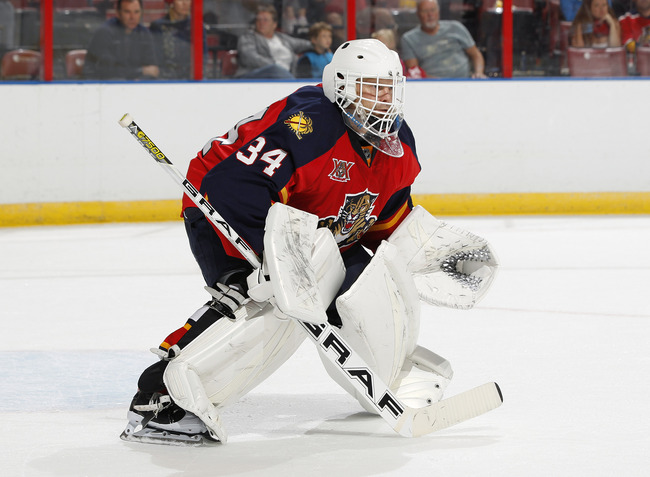 Hi-res-182257838-goaltender-tim-thomas-of-the-florida-panthers-defends_crop_650