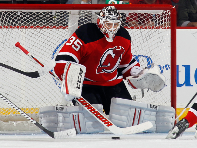 Hi-res-181951650-cory-schneider-of-the-new-jersey-devils-steers-the-puck_crop_650