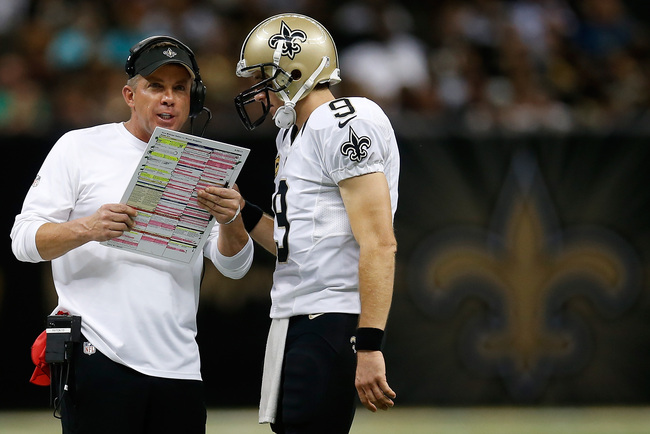 Hi-res-182567242-head-coach-sean-payton-talks-with-drew-brees-of-the-new_crop_650