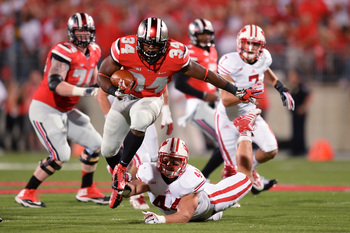 Hi-res-182260793-carlos-hyde-of-the-ohio-state-buckeyes-leaps-to-avoid-a_display_image