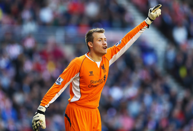 Hi-res-182300107-goalkeeper-simon-mignolet-of-liverpool-gives_crop_650