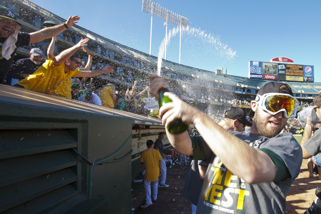 Hi-res-181602287-ryan-cook-of-the-oakland-athletics-celebrates-with-fans_crop_650