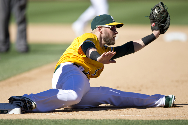 Hi-res-181607087-daric-barton-of-the-oakland-athletics-stretches-to_crop_650