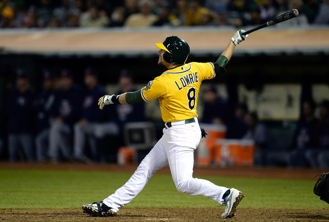 Hi-res-181231707-jed-lowrie-of-the-oakland-athletics-swings-and-watches_crop_650