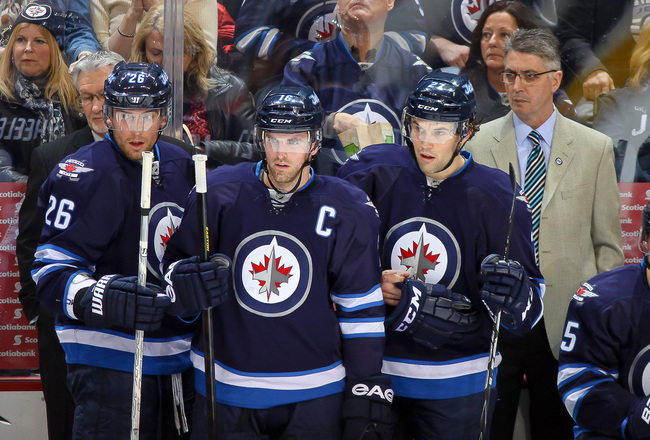 Hi-res-167319249-blake-wheeler-andrew-ladd-eric-tangradi-and-head-coach_crop_650x440