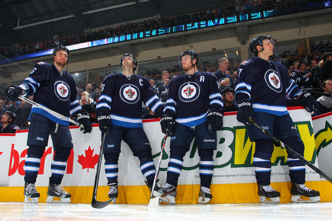 Hi-res-167935802-blake-wheeler-andrew-ladd-bryan-little-and-derek-meech_crop_650