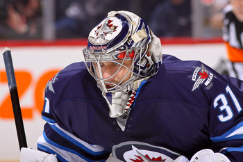 Hi-res-167935577-ondrej-pavelec-of-the-winnipeg-jets-looks-on-during_display_image