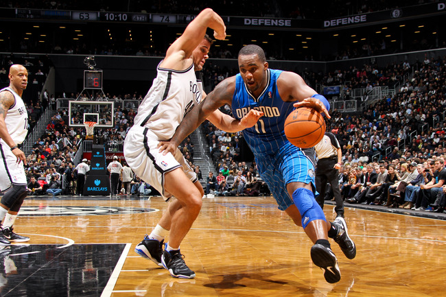 Hi-res-160299854-glen-davis-of-the-orlando-magic-drives-against-kris_crop_650