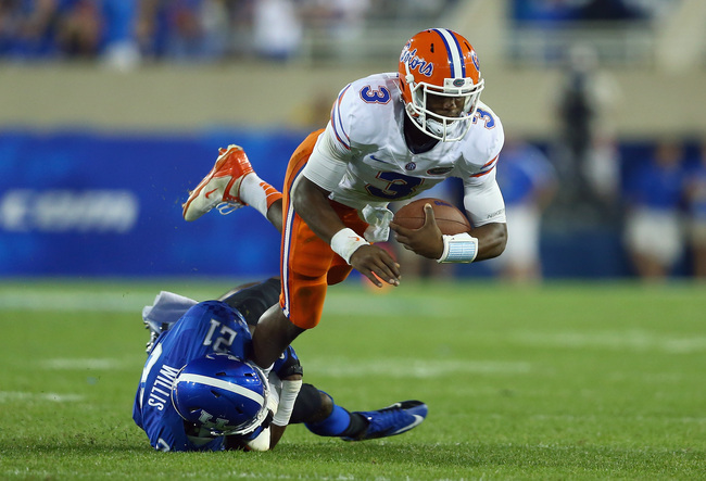 Hi-res-182263471-tyler-murphy-of-the-florida-gators-runs-with-the-ball_crop_650