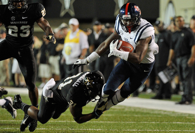 Hi-res-178544890-laquon-treadwell-of-the-ole-miss-rebels-is-tackled-by_crop_650