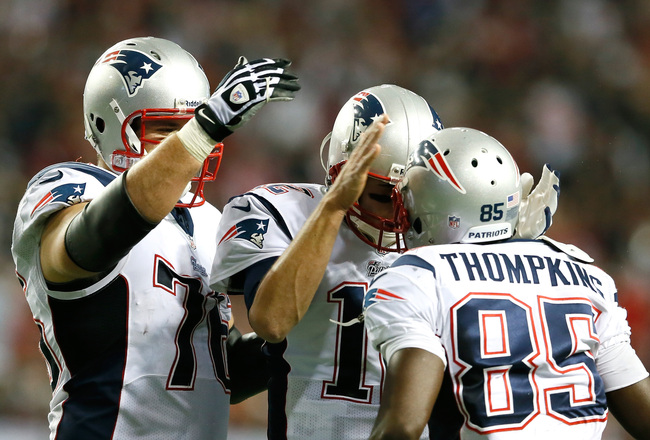 Hi-res-182451603-tom-brady-and-sebastian-vollmer-congratulates-kenbrell_crop_650x440